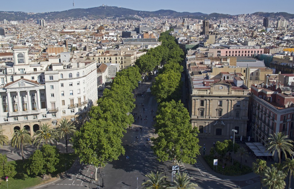 View of the Ramblas, or La Rambla street, in downtown Barcelona from the memorial column of Columbus in Barceloneta, Spain
