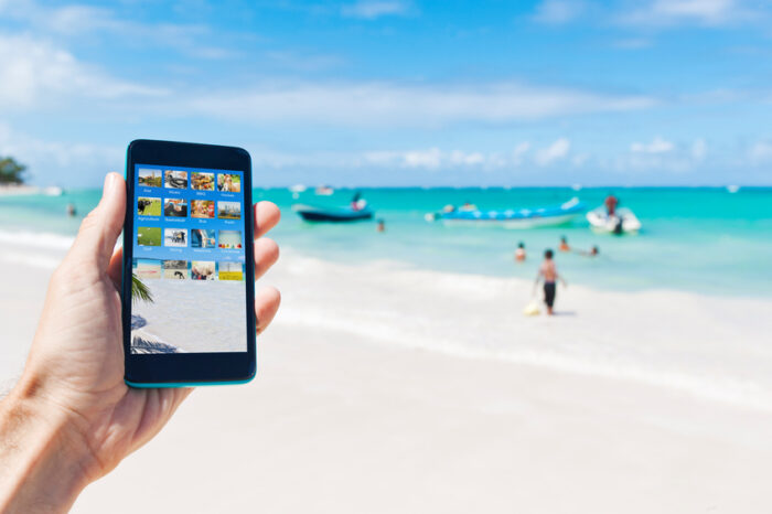 Tirando foto na praia Punta Cana da República Dominicana